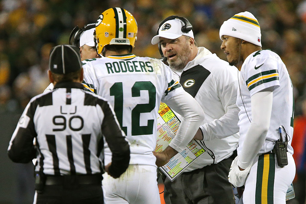 Head coach Mike McCarthy of the Green Bay Packers talks with quarterback Aaron Rodgers in the first quarter against the Chicago Bears at Lambeau Field on October 20, 2016 in Green Bay, Wisconsin.