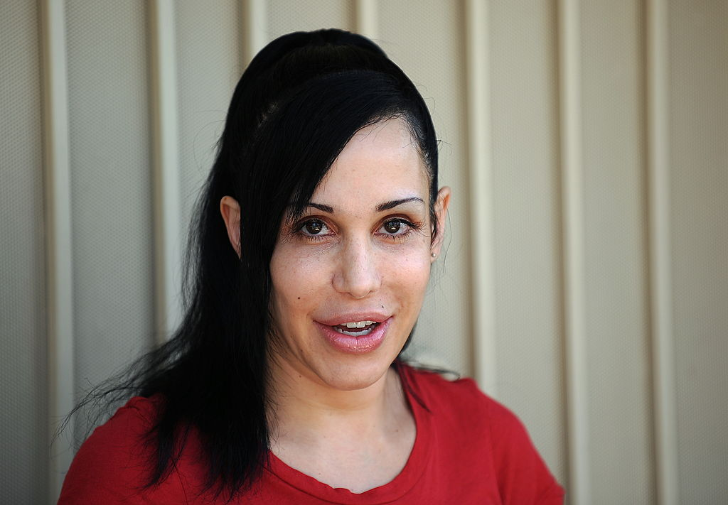 Nadya Suleman poses for photographers in front of her home in La Habra, California on May 19, 2010.