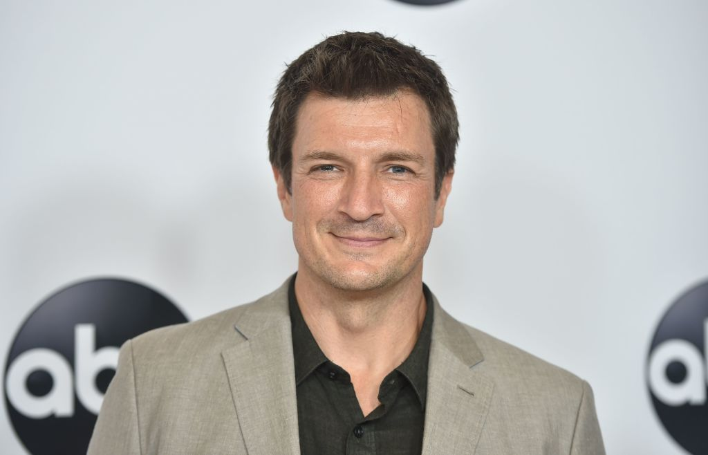 Actor Nathan Fillion smiles for the camera.