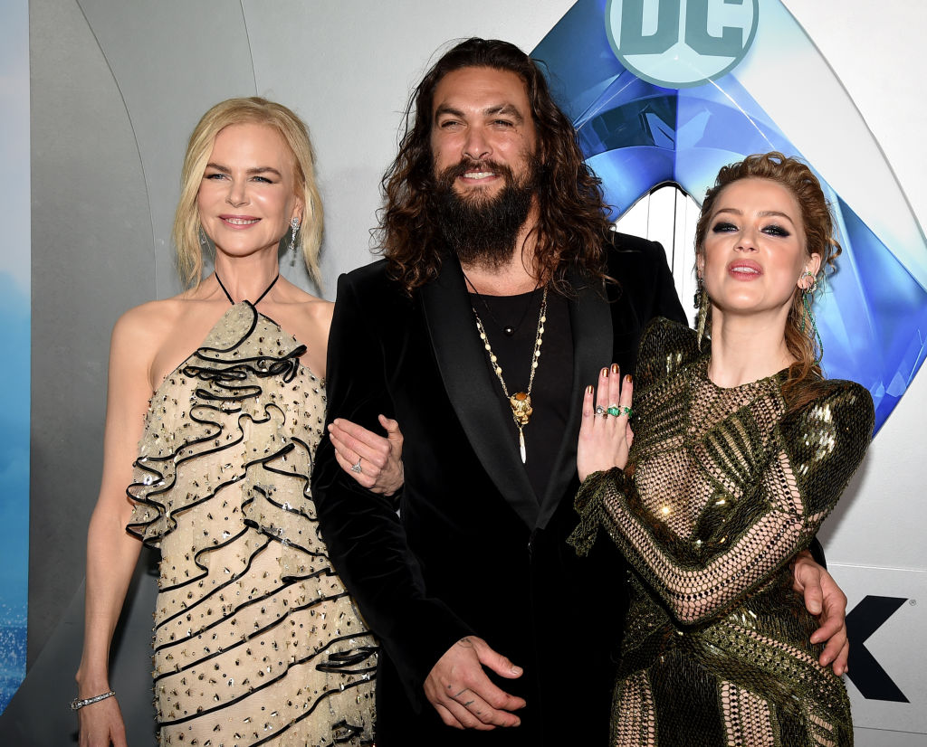 """(L-R) Nicole Kidman, Jason Momoa and Amber Heard arrive at the premiere of Warner Bros. Pictures' """"Aquaman"""" at the Chinese Theatre on December 12, 2018 in Los Angeles, California."""