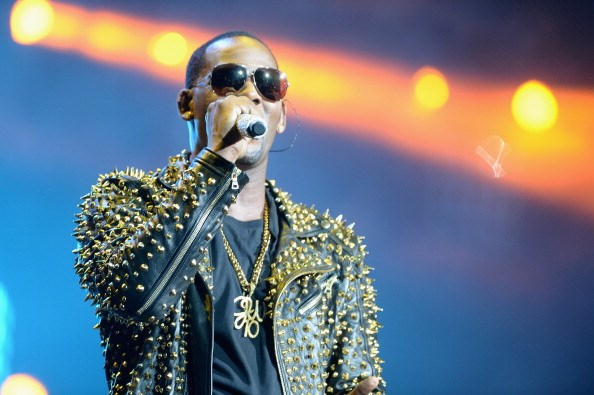 R. Kelly performs onstage during R. Kelly, New Edition and The Jacksons at the 2013 BET Experience