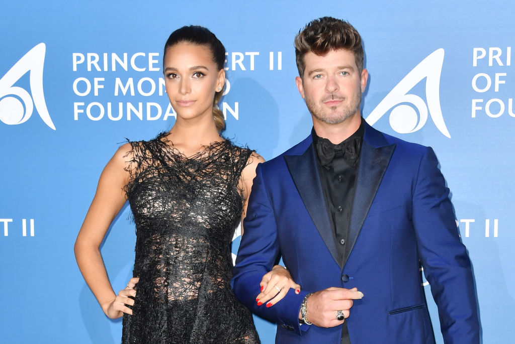 Robin Thicke and April Love Geary pose during the Monte-Carlo Gala for the Global Ocean in Monaco on September 28, 2017.