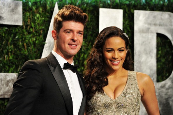 Robin Thicke and actress Paula Patton arrive at the 2012 Vanity Fair Oscar Party hosted by Graydon Carter at Sunset Tower on February 26, 2012 in West Hollywood, California.