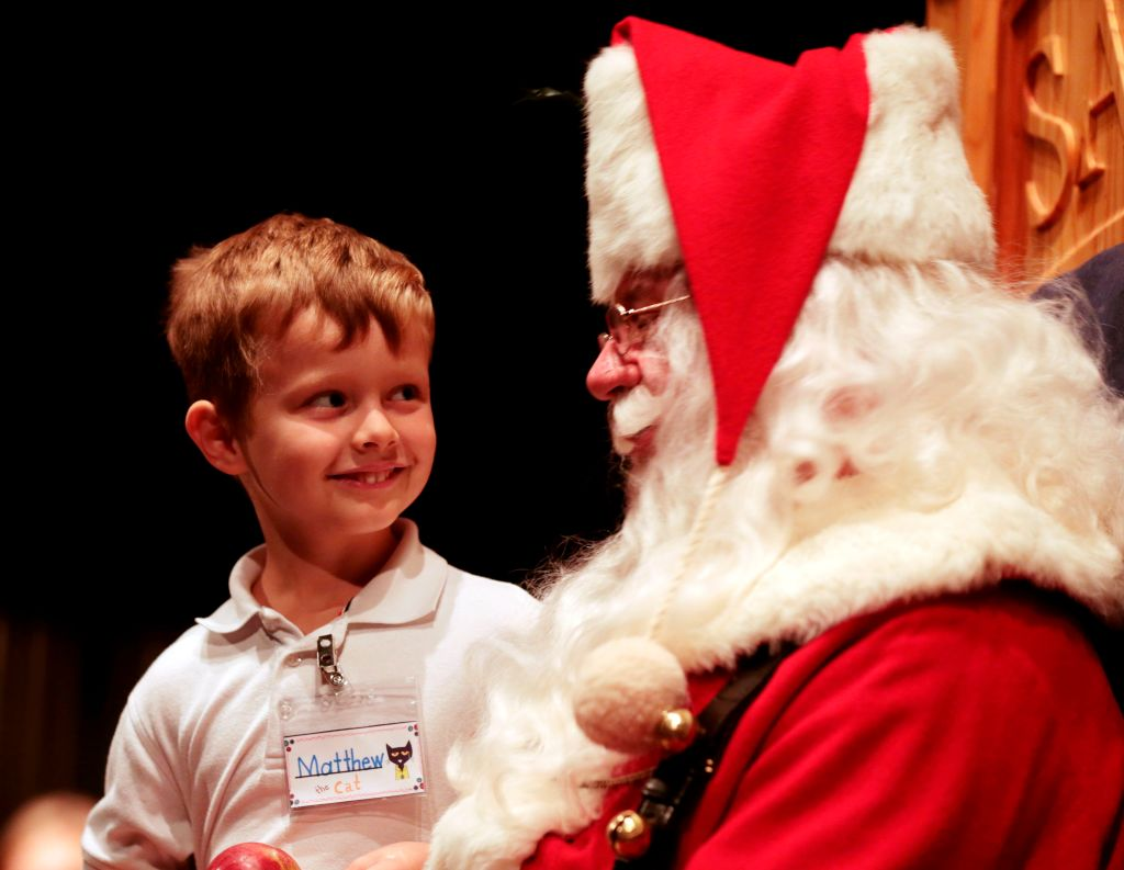 Child looks adoringly at Santa Claus