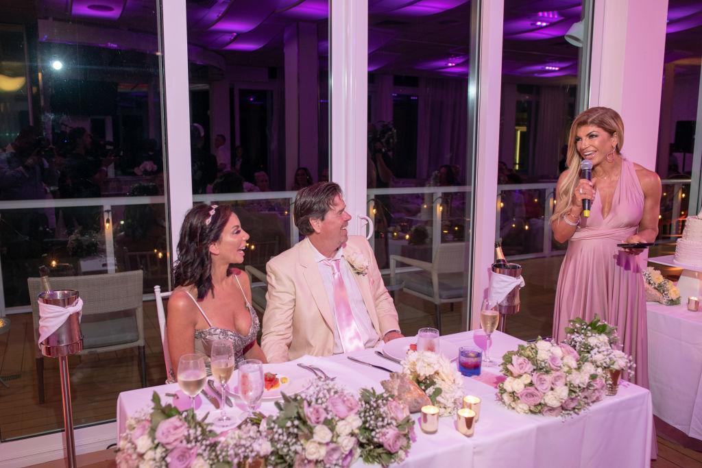 Teresa Giudice giving a toast at Danielle Staub and Marty Caffrey's wedding on May 5, 2018 in Bimini, Bahamas.