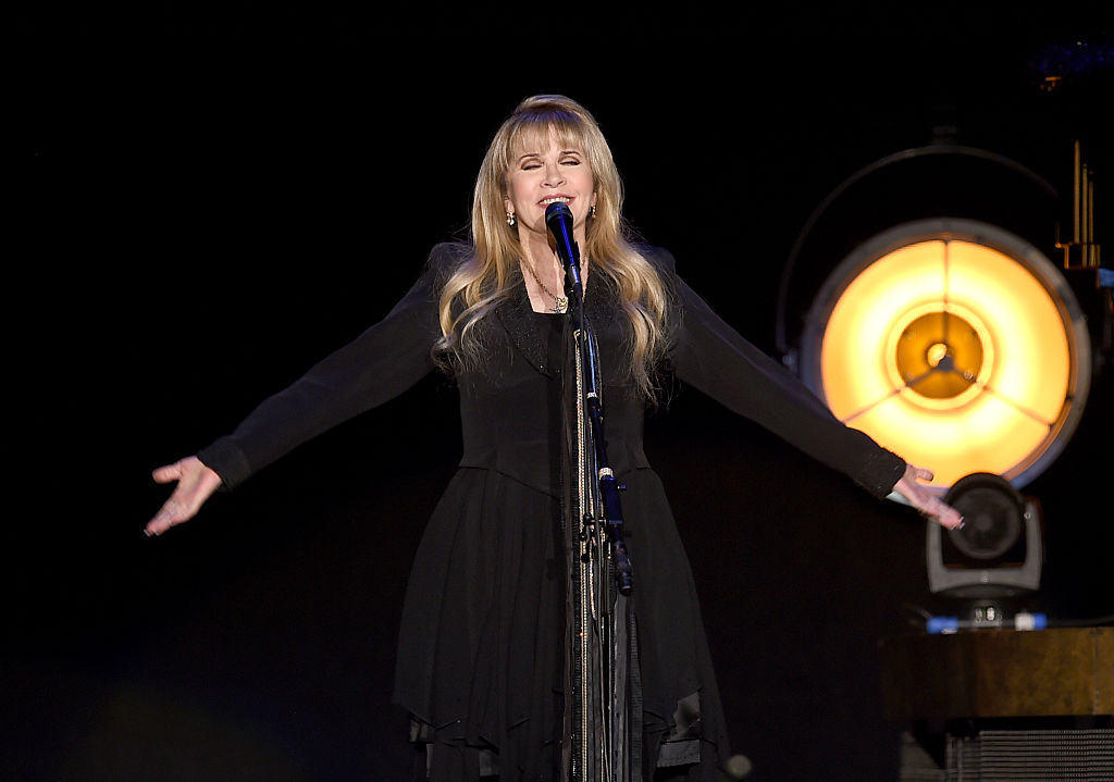 Stevie Nicks sings during a solo tour performance in 2016.