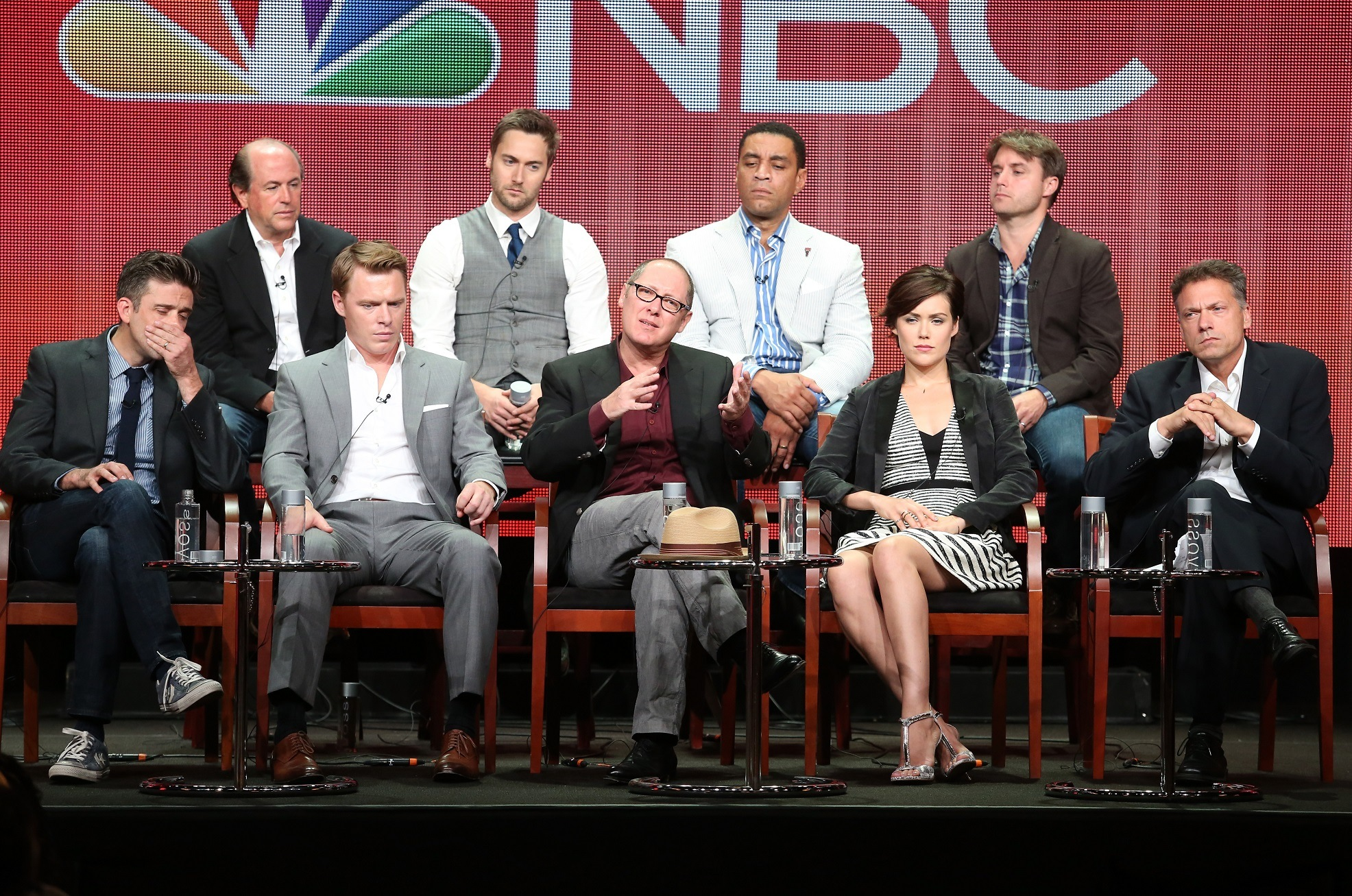 Megan Boone (front row, second from right) and the cast of NBC drama The Blacklist.