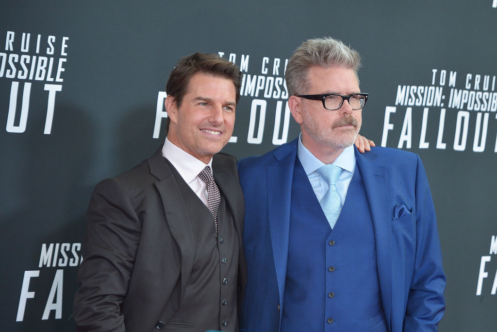 """Tom Cruise and director Christopher McQuarrie attend the U.S. Premiere of """"Mission: Impossible - Fallout"""" at Smithsonian's National Air and Space Museum on July 22, 2018 in Washington, DC."""