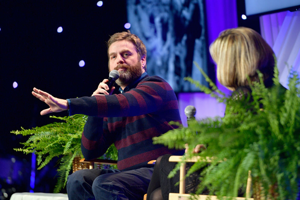Zach Galifianakis between two ferns at the 2018 Venice Family Clinic Silver Circle Gala.