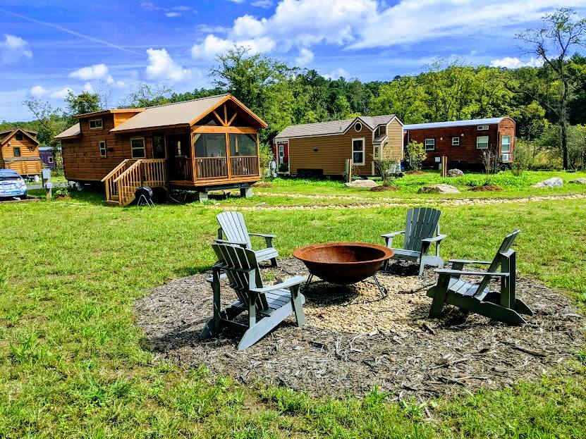 Tiny home village with fire pit