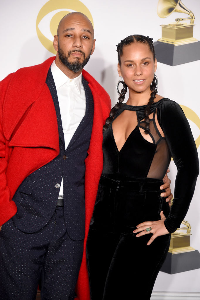 Swizz Beatz (L) and Alicia Keys pose in the press room during the 60th Annual GRAMMY Awards at Madison Square Garden on January 28, 2018 in New York City.