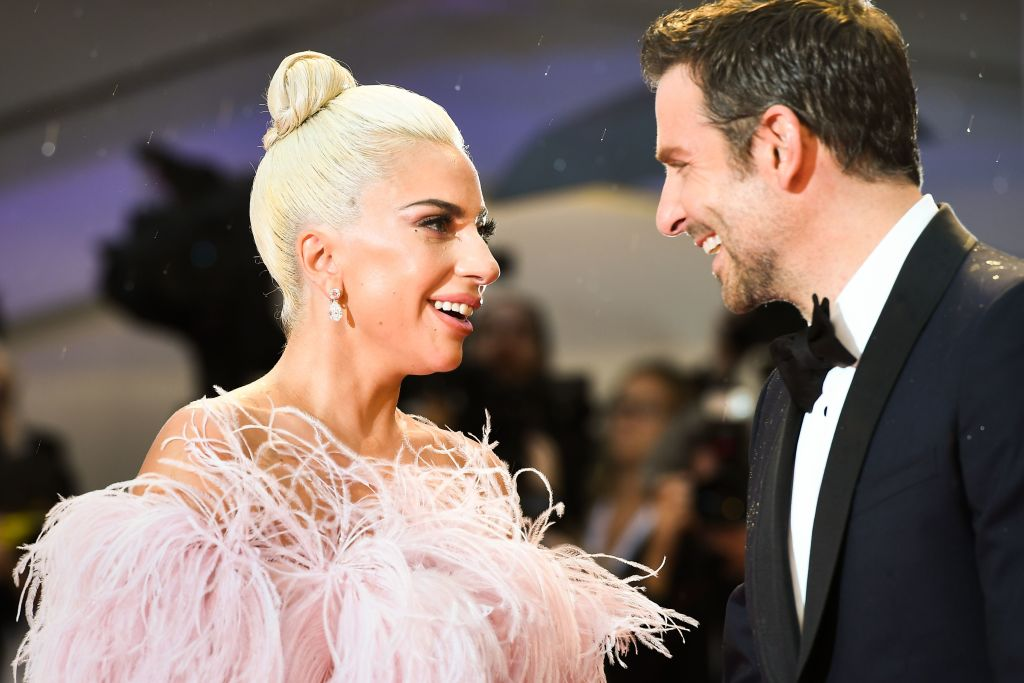 Lady Gaga and director and actor Bradley Cooper arrive for the premiere of the film