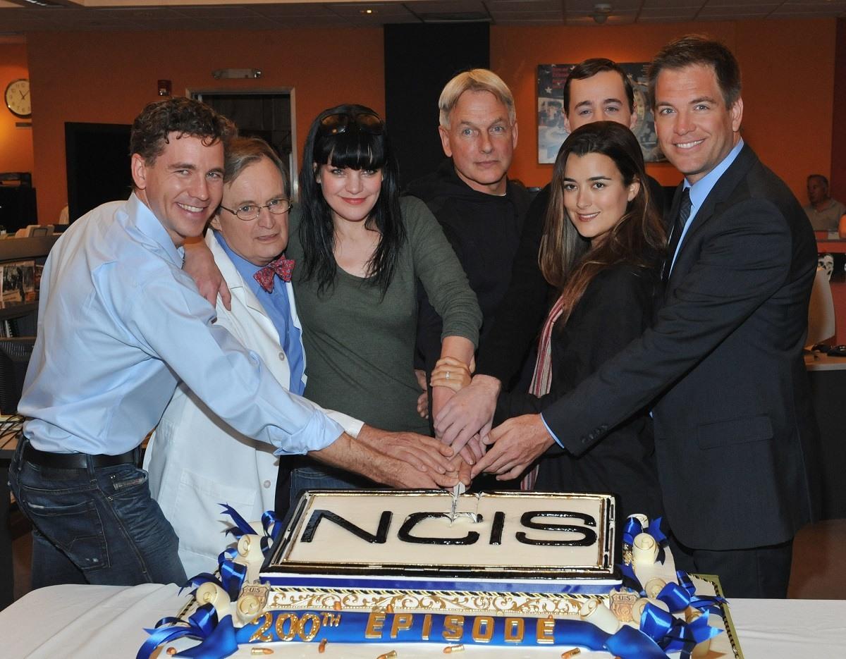 Brian Dietzen, David McCallum, Paukley Perrette, Mark Harmon, Sean Murray, Cote de Pablo, and Michael Weatherly celebrate 200 episodes of NCIS in 2012.