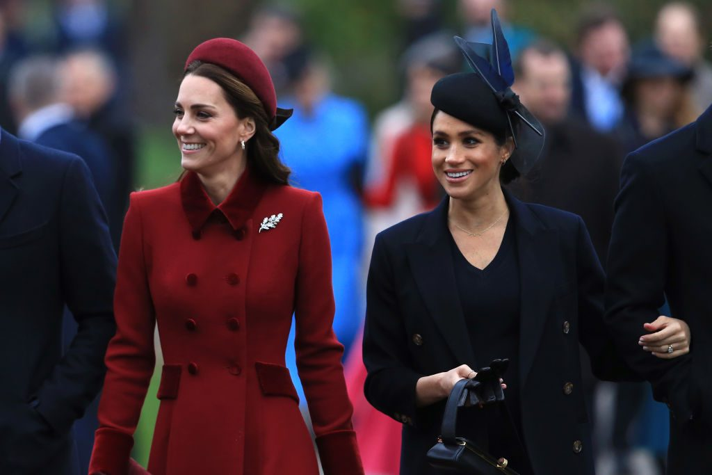 Kate Middleton, Duchess of Cambridge and Meghan Markle, Duchess of Sussex walking together.
