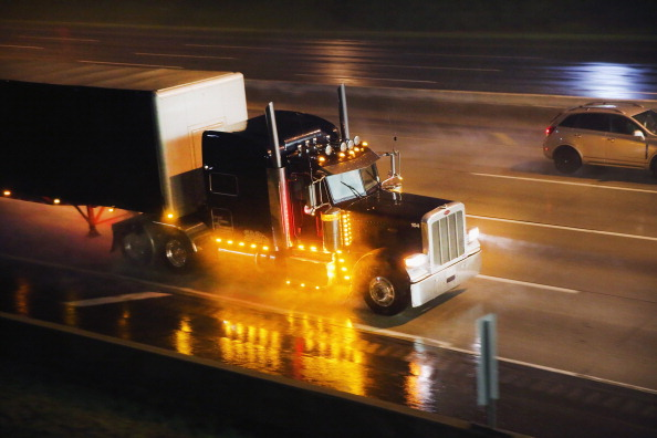 Tractor trailer driving in the rain