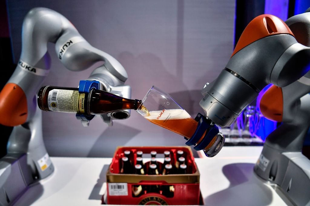 Robot arms pouring a beer