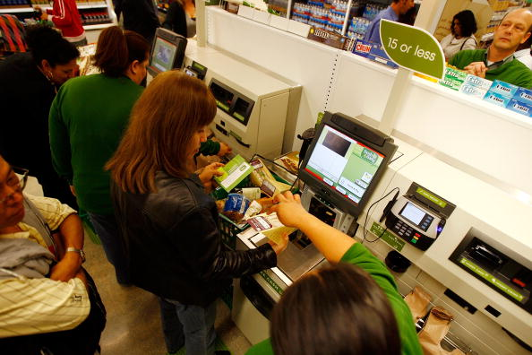Shoppers using self checkout stations