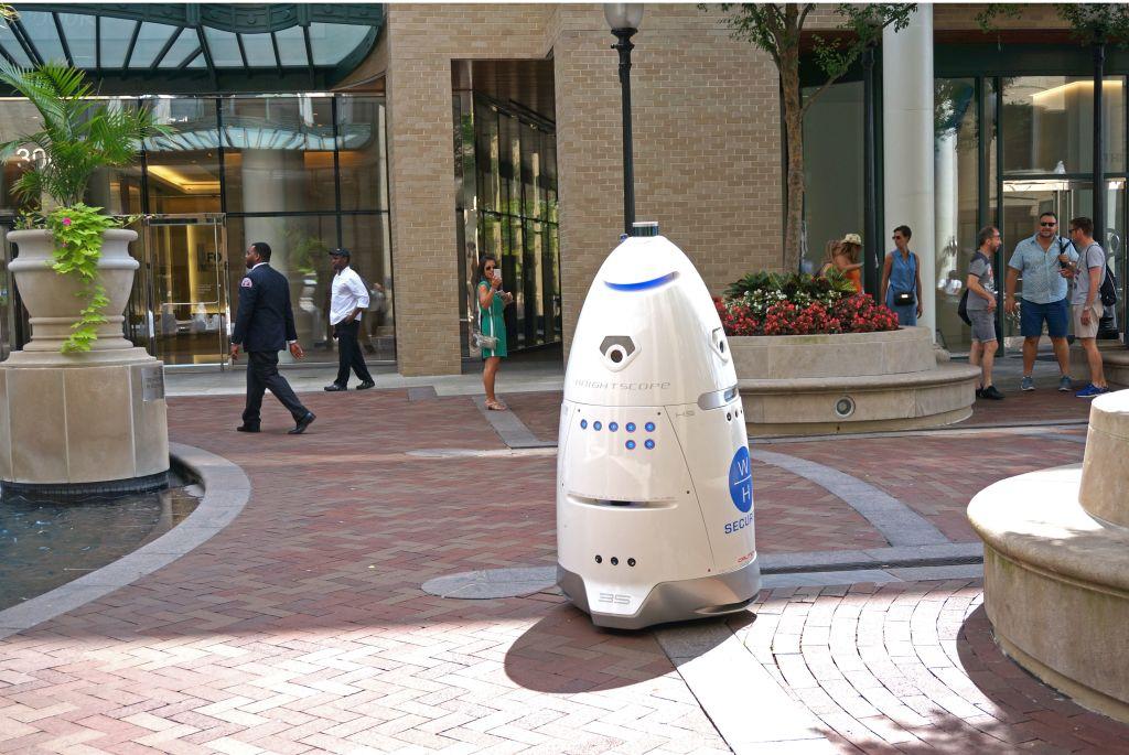 A robot patrols a community