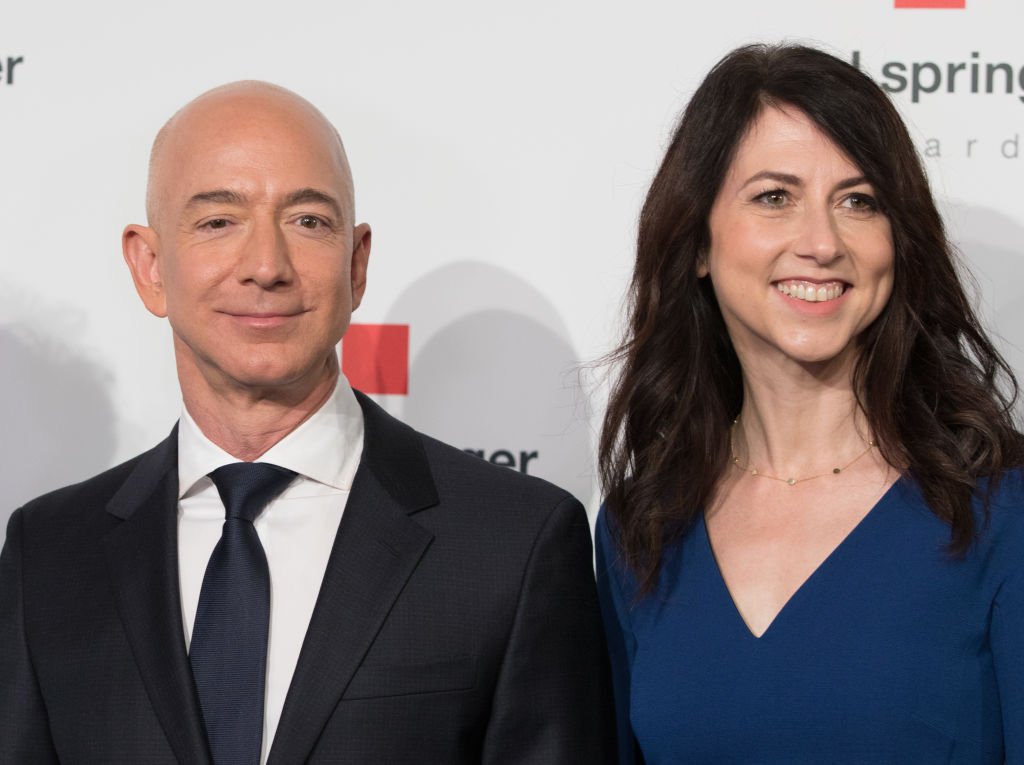 Amazon CEO Jeff Bezos and his wife MacKenzie Bezos pose as they arrive at the headquarters of publisher Axel-Springer where he will receive the Axel Springer Award 2018 on April 24, 2018 in Berlin.