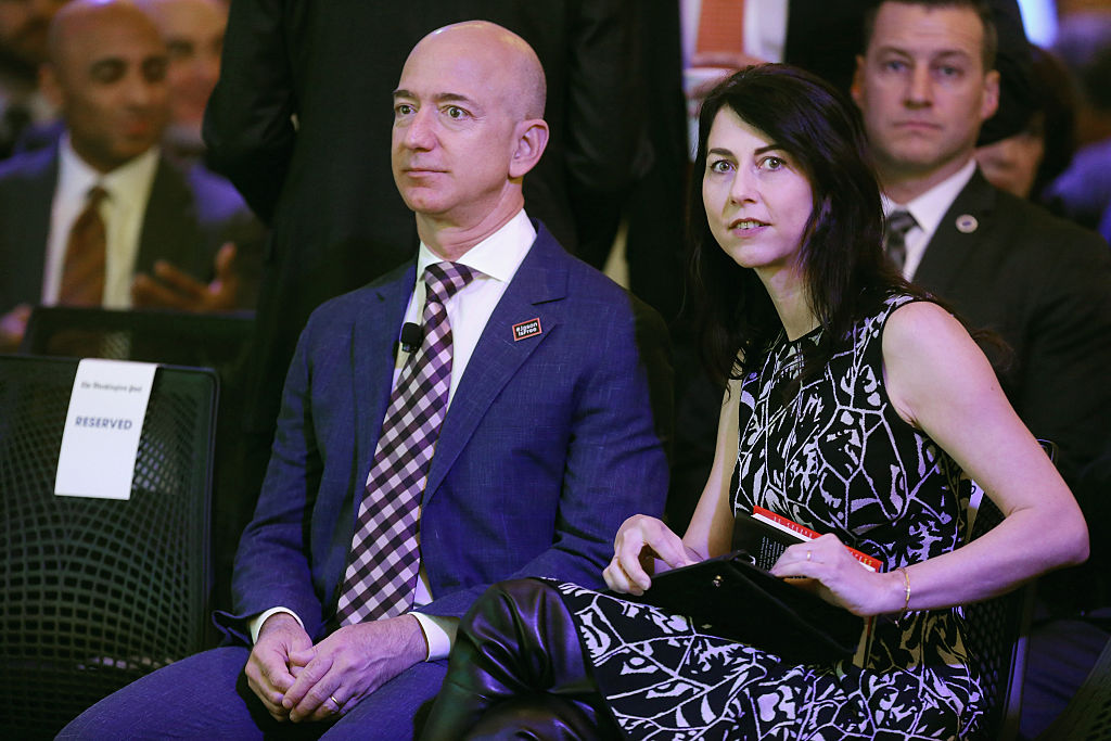 Jeff Bezos and his wife MacKenzie Bezos participate in the opening ceremony of the newspaper's new location January 28, 2016 in Washington, DC. Bezos purchased the newspaper and media company in October of 2013 from the storied Graham family.