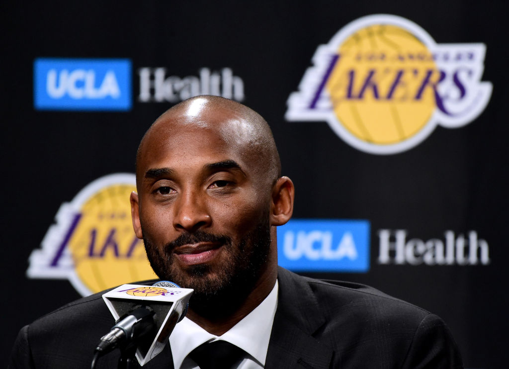 Kobe Bryant speaks to the media at a press conference before his #8 and #24 jerseys are retired by the Los Angeles Lakers at Staples Center on December 18, 2017 in Los Angeles, California.