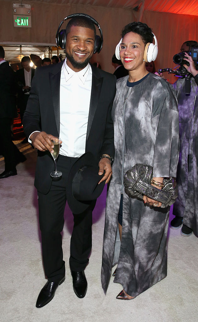 Usher (L) and Grace Miguel, wearing Samsung Level headphones, attend the 8th Annual HEAVEN Gala presented by Art of Elysium and Samsung Galaxy at Hangar 8 on January 10, 2015 in Los Angeles, California.