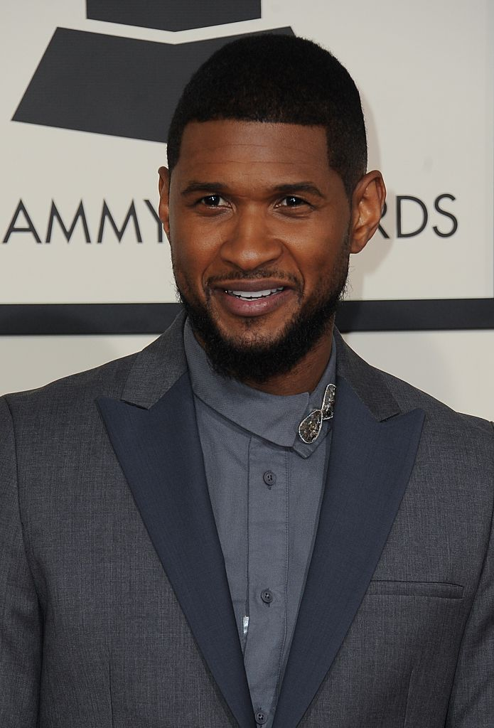 Usher arrives on the red carpet for the 57th Annual Grammy Awards in Los Angeles February 8, 2015.
