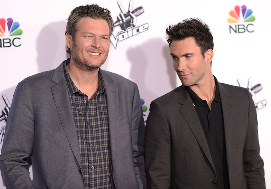 Adam Levine starring down Blake Shelton