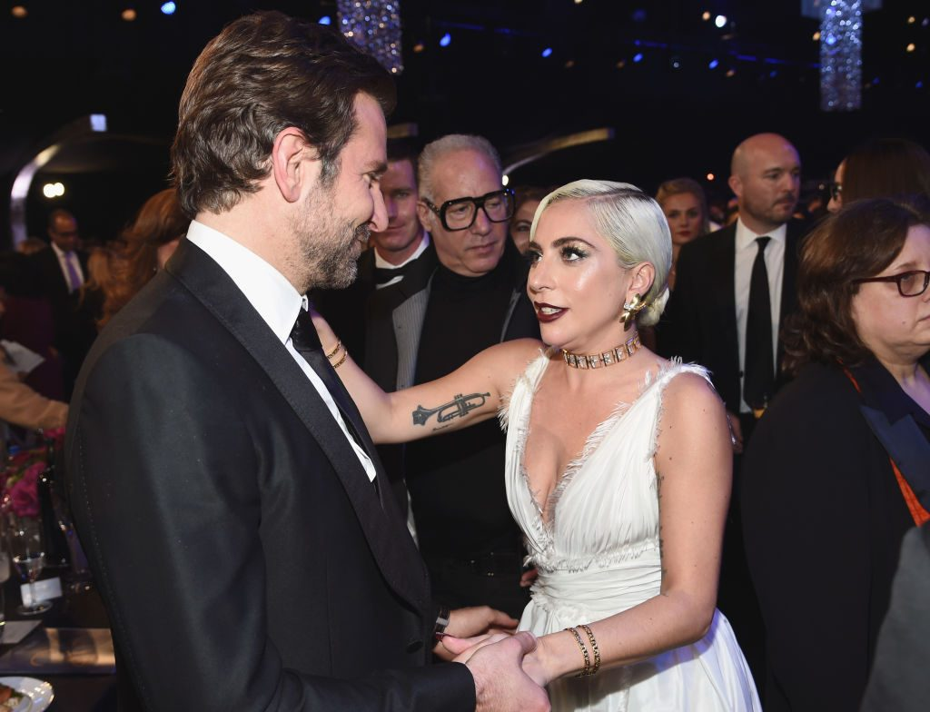 Bradley Cooper and Lady Gaga holding hands | Dimitrios Kambouris/Getty Images for Turner