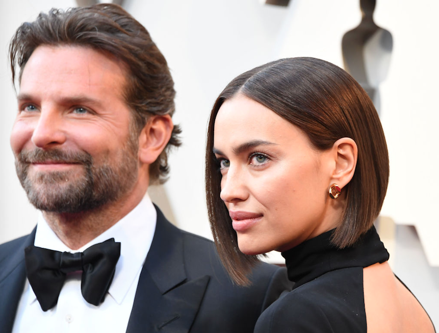 Bradley Cooper and Irina Shayk posing for photos at the Oscars