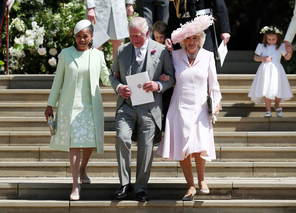 Prince Charles escorts Camilla and Doria down the steps of St. George's Chapel.