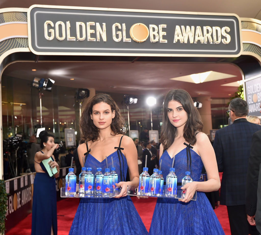 Kelleth Cuthbert and another Fiji Water girl at the Golden Globes