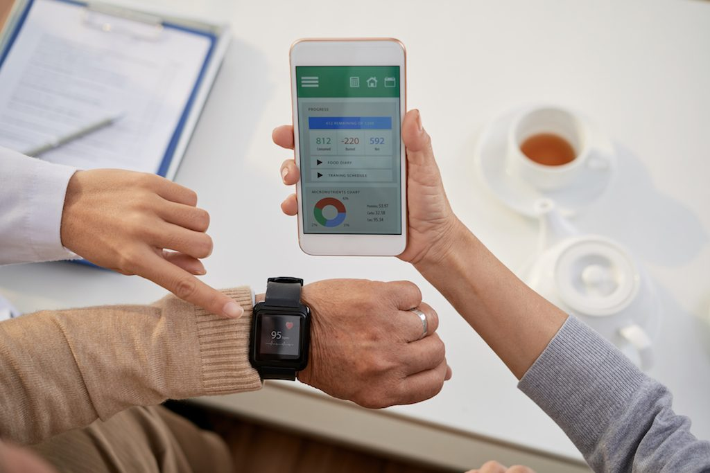 A man learning how to monitor his heart rate on an app