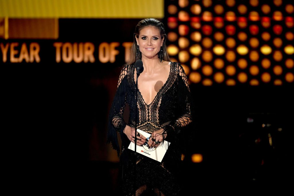 Heidi Klum speaks onstage during the 2018 American Music Awards at Microsoft Theater on October 9, 2018 in Los Angeles, California. | Kevin Winter/Getty Images For dcp