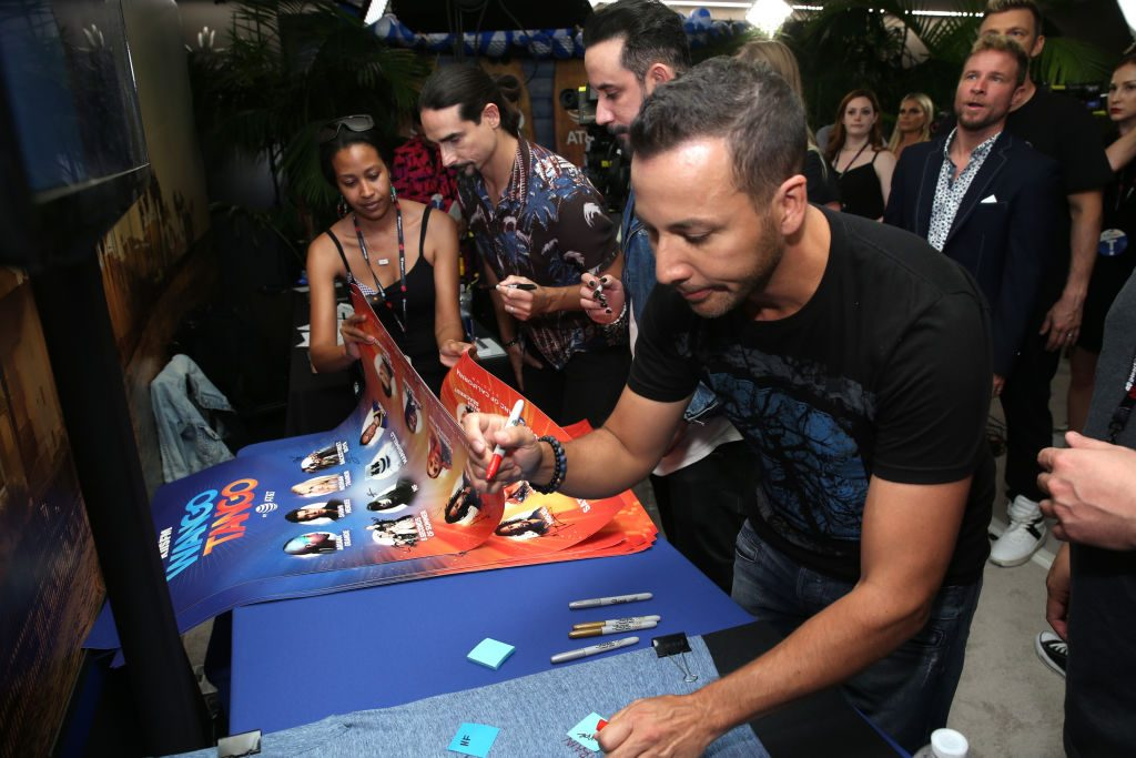 Kevin Richardson, AJ McLean and Howie Dorough of the Backstreet Boys sign posters backstage at the 2018 iHeartRadio Wango Tango by AT&T at Banc of California Stadium on June 2, 2018 in Los Angeles, California.