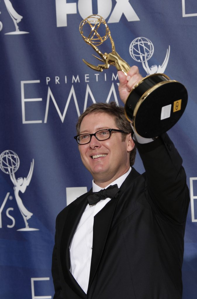 James Spader, star of The Blacklist, hoists an Emmy award