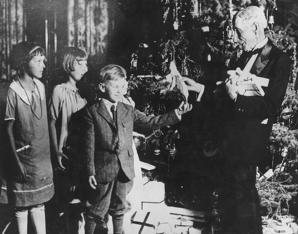 John D Rockefeller Sr handing out Christmas gifts