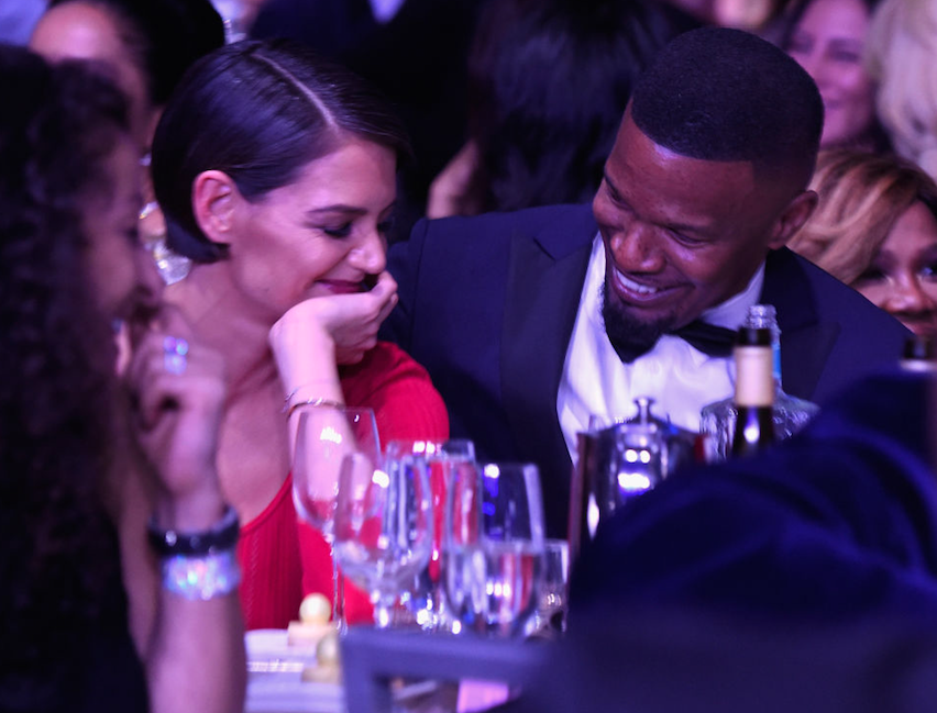 Katie Holmes laughing with Jamie Foxx