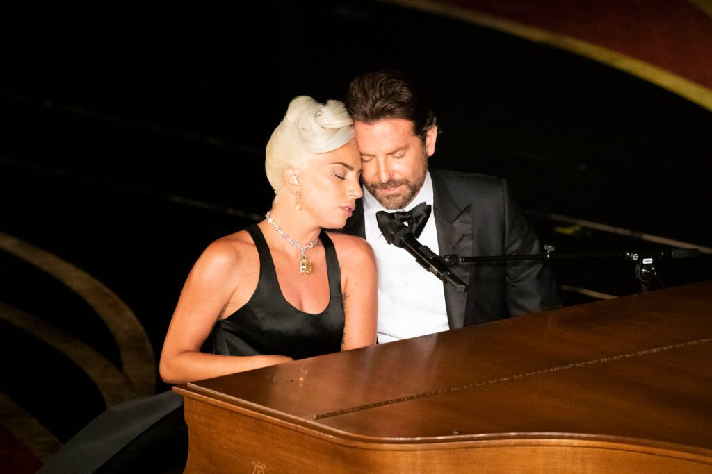 Lady Gaga and Bradley Cooper at the piano | Ed Herrera via Getty Images