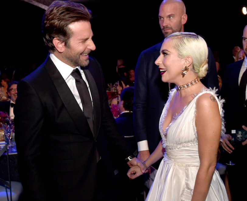 Bradley Cooper laughing with Lady Gaga