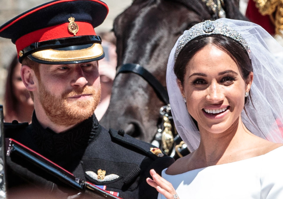 Meghan and Harry together smiling