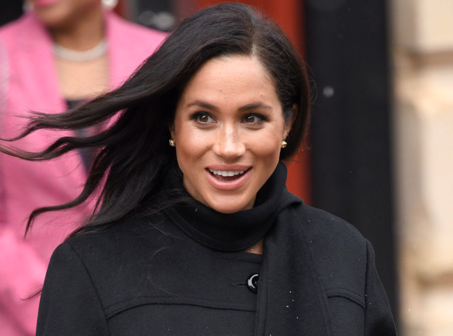 Meghan admits to being 'camera shy' as she comforts nervous Shetland pony
