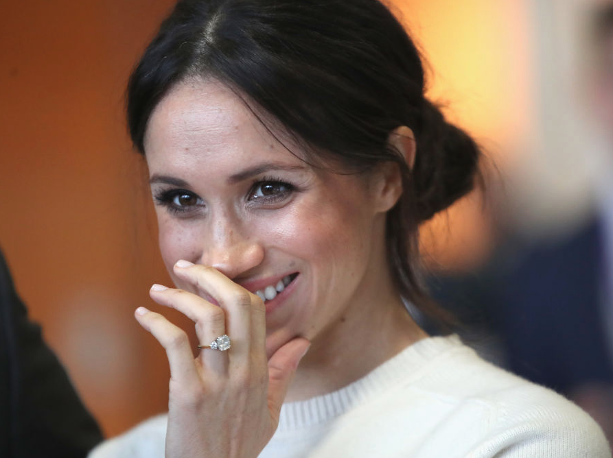 Meghan Markle hiding her mouth