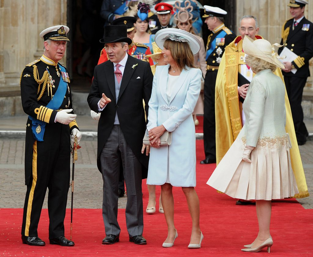 Michael and Carole Middleton chat with Prince Charles and Camilla Parker Bowles following Kate Middleton and Prince William's royal wedding.