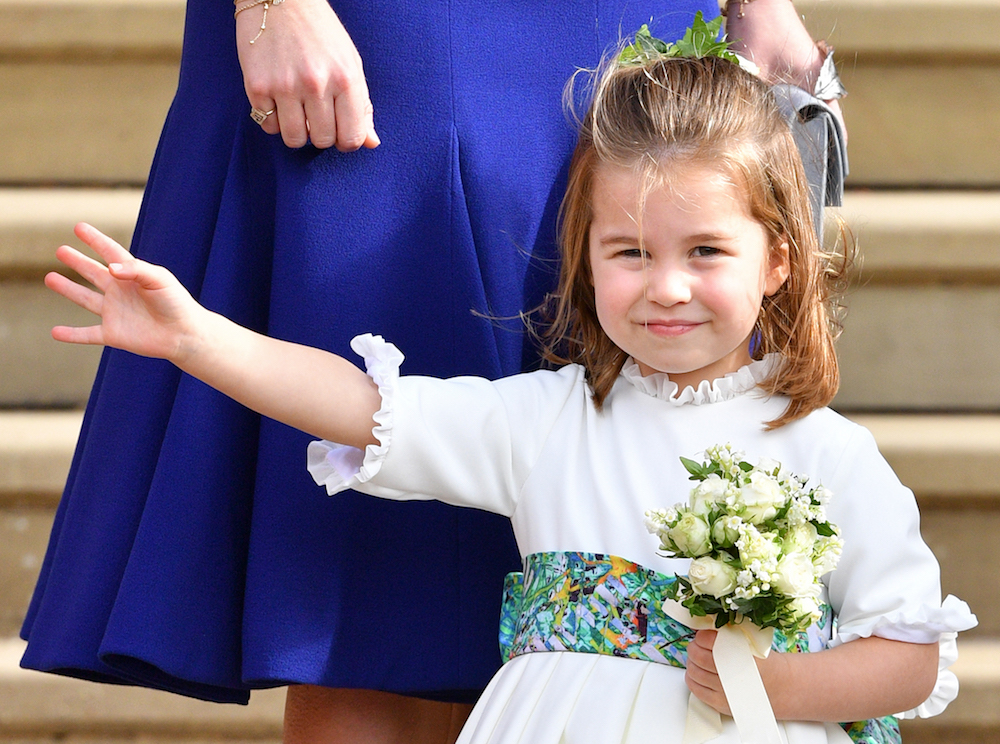 Princess Charlottes waves to crowd at Prince Harry and Meghan Markle's royal wedding.