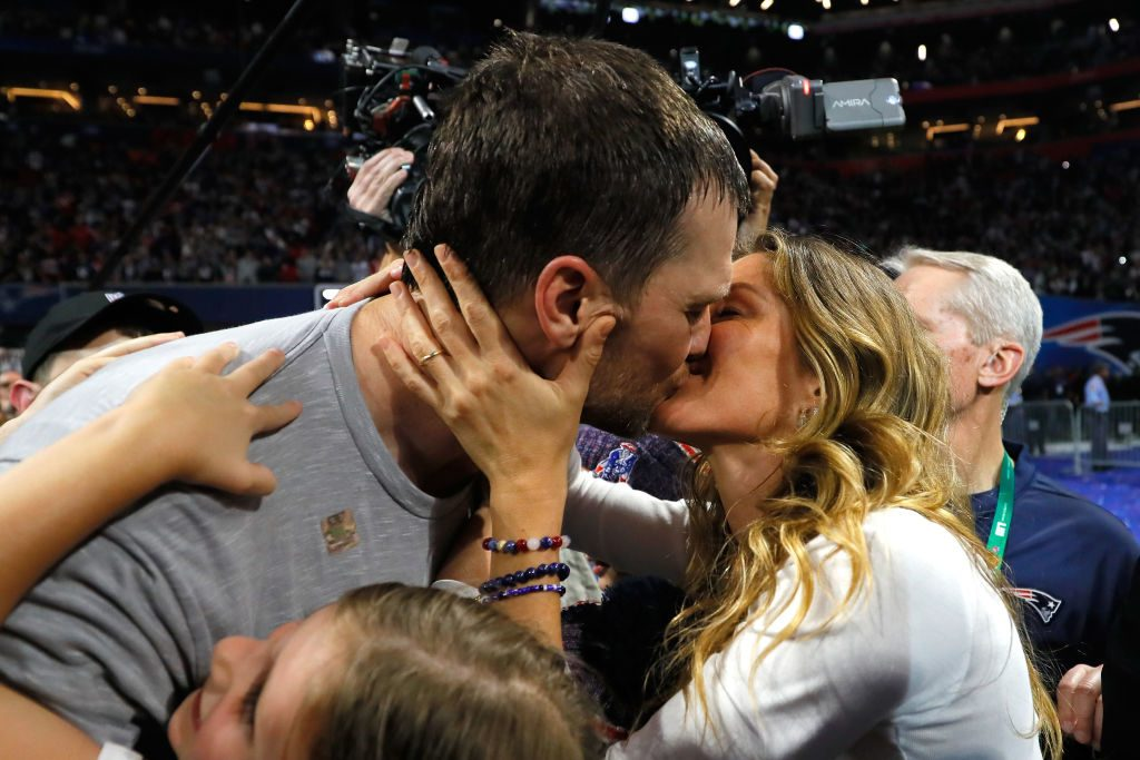 Tom Brady #12 of the New England Patriots kisses his wife Gisele Bündchen after the Super Bowl LIII against the Los Angeles Rams at Mercedes-Benz Stadium on February 3, 2019 in Atlanta, Georgia. The New England Patriots defeat the Los Angeles Rams 13-3.