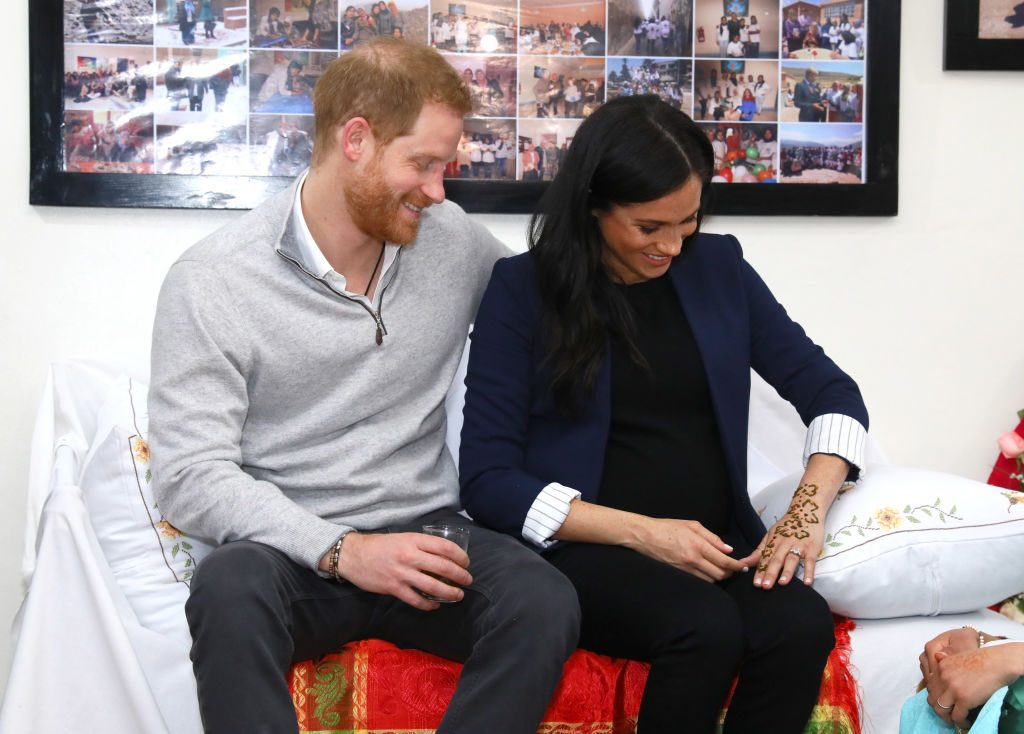 Prince Harry and Meghan Markle, receiving henna tattoo, during visit to Morocco.
