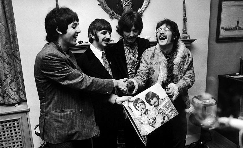 The Beatles (left  to right) George Harrison (1943 - 2001), Ringo Starr, John Lennon (1940 - 1980) and Paul McCartney, hold the sleeve of their new LP, 'Sgt. Pepper's Lonely Hearts Club Band', at the press launch for the album, held at Brian Epstein's house at 24 Chapel Street, London, 19th May 1967.
