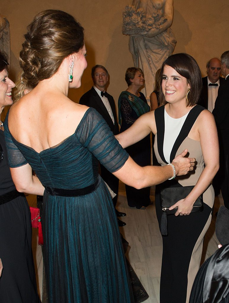 Catherine greets Princess Eugenie at the St. Andrews 600th Anniversary Dinner