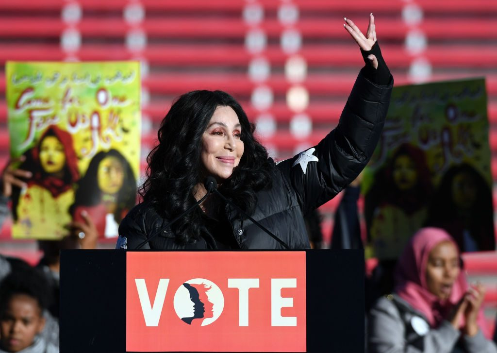 Cher waves after speaking during the 2018 Women's March